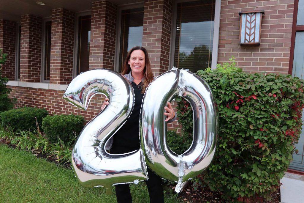 Woman holding balloon 20