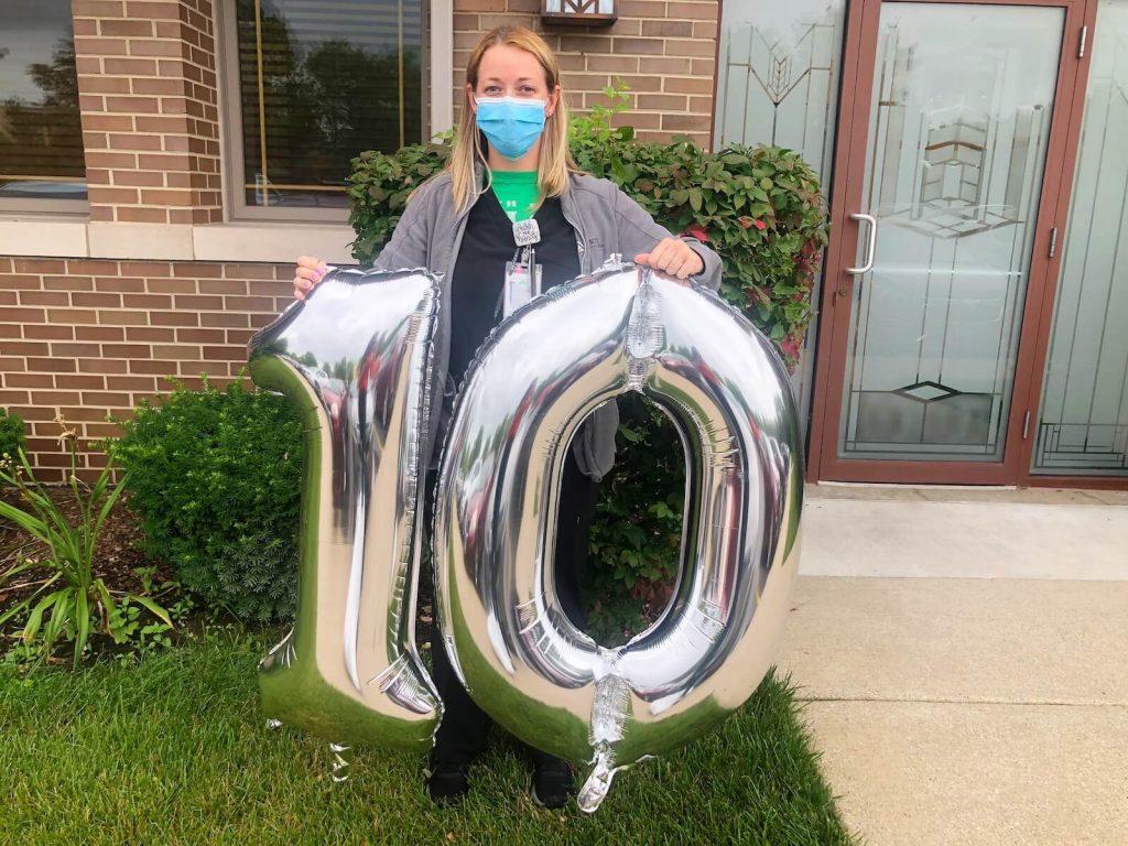 Woman holding balloon 10