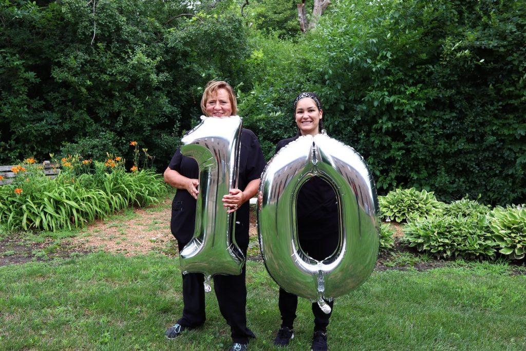 2 women holding balloon 10